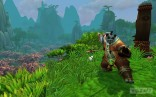Male_Pandaren_monk_in_a_fighting_stance_overlooking_a_field_of_cherry_blossoms_in_Jade_Forest