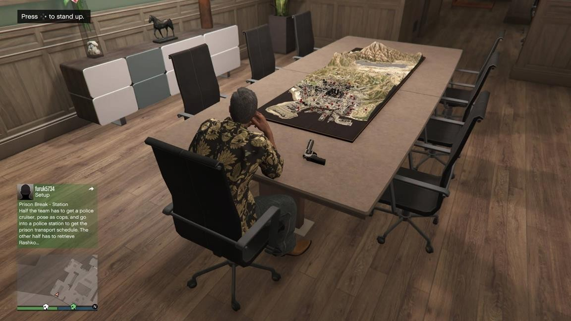 gta_boardroom_gun_out