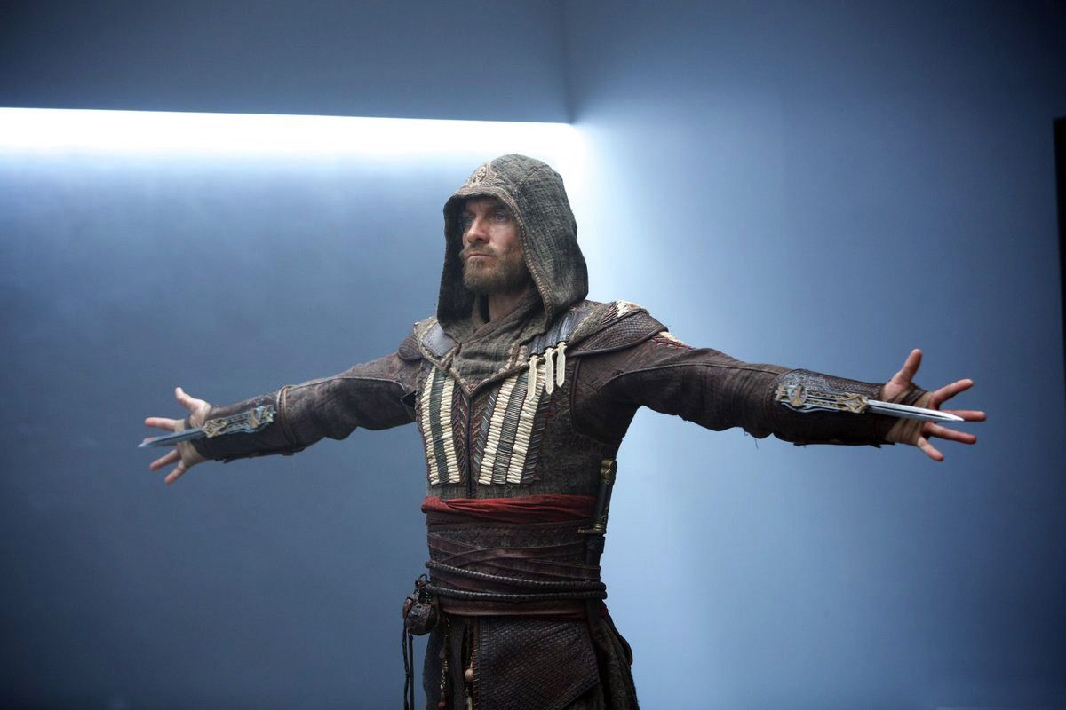 Michael Fassbender strikes a familiar pose in these Assassin's Creed movie stills