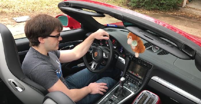 Man mods his Porsche 911 to play Doom using the steering wheel