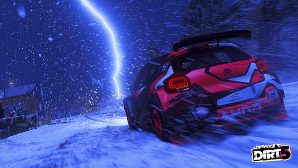 Dirt 5 screen shot night time driving in the ice and snow.
